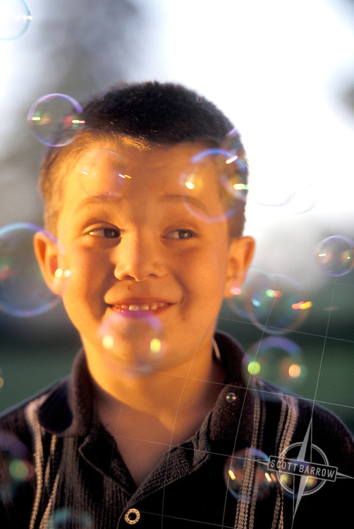 Boy surrounded by bubbles
