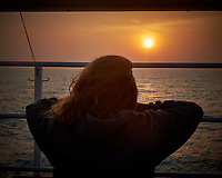 Sun rising through an orange haze over the East Vietnam Sea from the deck of the MV World Odyssey. Image taken with a Fuji X-T1 camera and 35 mm f/1.4 lens (ISO 200, 35 mm, f/11, 1/125 sec)
