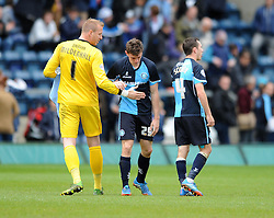 Wycombe Wanderers'  goal scorer Matt McClure cuts a dejected figure as his team lose 2 - 1 to Bristol Rovers - Photo mandatory by-line: Dougie Allward/JMP - Mobile: 07966 386802 26/04/2014 - SPORT - FOOTBALL - High Wycombe - Adams Park - Wycombe Wanderers v Bristol Rovers - Sky Bet League Two