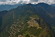 Panoramic view of the lost inca city of Machu Picchu, in Cusco, Peru. Showing the route of access by bus.