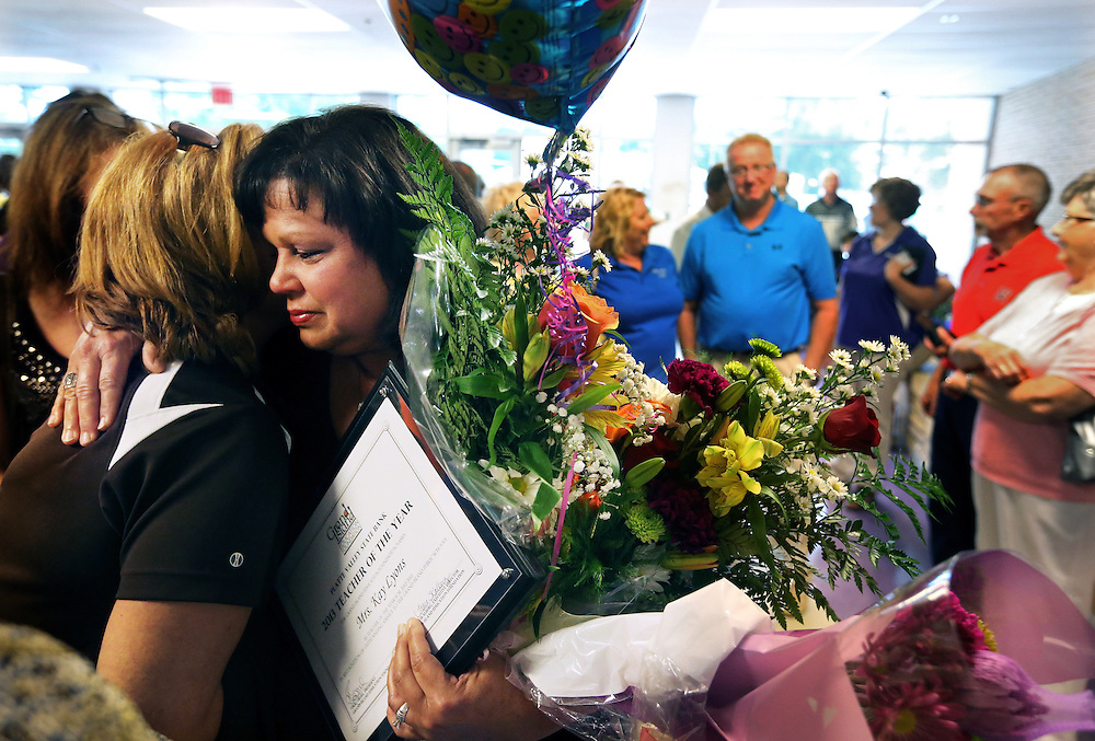 Walnut Music teacher Kay Lyons hugs one of many supporters that came to congratulate her on her Teacher of the Year award which she received during the annual all-staff assembly for Grand Island Public Schools Friday at Grand Island Senior High. (Independent/Matt Dixon)