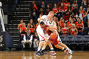 Nov 6, 2010; Charlottesville, VA, USA; Roanoke College g Melvin Felix (12) drives into Virginia Cavaliers f James Johnson (34) Saturday afternoon in exhibition action at John Paul Jones Arena. The Virginia men's basketball team recorded an 82-50 victory over Roanoke College.