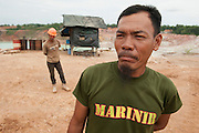 Eep (40). Supervisor in the mine, earns 800 euros a month. Pemali mine,  the biggest legal mine in Bangka that has completely devastated the once green landscape. Operated by PT-Timah. It produces 60 tons of tin per month. Bangka Island (Indonesia) is devastated by illegal tin mines. The demand for tin has increased due to its use in smart phones and tablets.<br /> <br /> <br /> Eep (40 ans). Superviseur dans la mine, gagne 800 euro par mois.  Mine de Pemali, plus grande mine légale de Bangka. Exploité par PT-Timah. Elle produit 60 tonnes d'étain par mois. <br /> L'île de Bangka (Indonésie) est dévastée par des mines d'étain. La demande de l'étain a explosé à cause de son utilisation dans les smartphones et tablettes.
