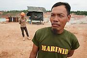 Eep (40). Supervisor in the mine, earns 800 euros a month. Pemali mine,  the biggest legal mine in Bangka that has completely devastated the once green landscape. Operated by PT-Timah. It produces 60 tons of tin per month. Bangka Island (Indonesia) is devastated by illegal tin mines. The demand for tin has increased due to its use in smart phones and tablets.<br /> <br /> <br /> Eep (40 ans). Superviseur dans la mine, gagne 800 euro par mois.  Mine de Pemali, plus grande mine légale de Bangka. Exploité par PT-Timah. Elle produit 60 tonnes d'étain par mois. <br /> L'île de Bangka (Indonésie) est dévastée par des mines d'étain. La demande de l'étain a explosé à cause de son utilisation dans les smartphones et tablettes.