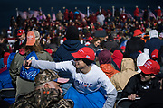Crowds gather before a 'Make America Great Again' rally in Duluth, Minnesota, U.S. on Wednesday, Sept. 30, 2020. Trump and Democratic nominee Joe Biden began their first debate on an acrimonious note and quickly made it personal, with each candidate interrupting and talking over each other. Photographer: Ben Brewer/Bloomberg