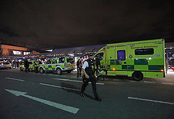 Emergency services outside London City Airport which has reopened after dozens of passengers were treated for breathing difficulties after a suspected chemical incident at the airport.