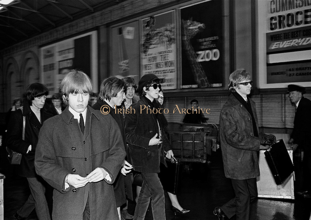 The Rolling Stones Charlie is my Darling - Ireland 1965...The Rolling Stones roll into Dublin by train from Belfast at Amiens Street station (now Connolly station) for thier concert at the Adelphi Theatre. L-R: Bill Wyman (bass), Brian Jones (guitar), Charlie Watts (drums), Mick Jagger (vocals), Keith Richards (guitar) and  manager Andrew Loog Oldham. This was the band's first Irish tour of 1965...07/01/1965.01/07/1965.07 January 1965..The Rolling Stones Charlie is my Darling - Ireland 1965.<br /> Thank you gifts of Limited Edition Prints of Charlie Watts, Mick Jagger, Keith Richards,  Bill Wyman,  The Rolling Stones, Charlie is my Darling, Ireland 1965.  <br /> Cool gifts of Limited Edition Prints of Charlie Watts, Mick Jagger, Keith Richards,  Bill Wyman,  The Rolling Stones, Charlie is my Darling, Ireland 1965.  <br /> Wedding gifts  of Limited Edition Prints of Charlie Watts, Mick Jagger, Keith Richards,  Bill Wyman,  The Rolling Stones, Charlie is my Darling, Ireland 1965.  <br /> Romantic gifts of Limited Edition Prints of Charlie Watts, Mick Jagger, Keith Richards,  Bill Wyman,  The Rolling Stones, Charlie is my Darling, Ireland 1965.  <br /> Anniversary gifts of Limited Edition Prints of Charlie Watts, Mick Jagger, Keith Richards,  Bill Wyman,  The Rolling Stones, Charlie is my Darling, Ireland 1965.