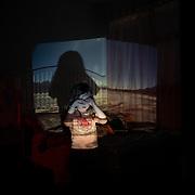Millie with slide of sulfur lake in Salar de Uyuni project onto her bedroom.