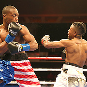 VERONA, NY - JUNE 09:  Charles Conwell (L) throws a left hook to the head of Jeffrey Wright during a ShoBox boxing match at the Turning Stone Resort Casino on June 9, 2017 in Verona, New York. (Photo by Alex Menendez/Getty Images) *** Local Caption *** Charles Conwell; Jeffrey Wright