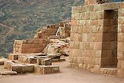 Elaborate water canals and temple walls built with carved stones at the Inca ruins above Pisac in the Sacred Valley, Peru.