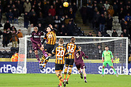 Hull City defender Tommy Elphick (35) heads the ball whilst being challenged by Swansea City midfielder Leroy Fer (8)  during the EFL Sky Bet Championship match between Hull City and Swansea City at the KCOM Stadium, Kingston upon Hull, England on 22 December 2018.