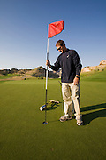 Bob Sorensen, an assistant golf course superintendent of The Golf Club at Redlands Mesa in Grand Junction, Colorado conducts a routine inspection of the golf course. (Bob Sorensen is featured in the book What I Eat: Around the World in 80 Diets.) He played football at Mesa State College in Grand Junction and graduated with a degree in criminal justice. Just before he took a desk job in his chosen profession he decided that he didn't want a desk job and found one that requires his constant attendance of the great outdoors, at a golf course at the foot of the majestic Colorado National Monument., He earned a second degree in turf management, supervises a small crew of greenskeepers, and coaches high school football at Palisade High School.