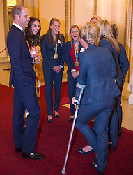 The Duke and Duchess of Cambridge meet the ladies Hockey Team with Susannah Townsend on crutches during a reception for Team GB and ParalympicsGB medallists from the 2016 Olympic and Paralympic Games at Buckingham Palace in London.