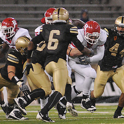 Oct 23, 2009; West Point, N.Y., USA; Rutgers running back Joe Martinek (38) drags several Army defenders during Rutgers' 27 - 10 victory over Army at Michie Stadium.