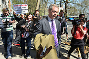 © London News Pictures. 03/05/2013. London, UK. UKIP party leader NIGEL FARAGE surrounded by media in Victoria Gardens, Westminster, central London following his party's success in the council elections across England.Photo credit : Stephen Simpson/LNP