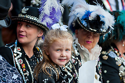 © Licensed to London News Pictures. 25/09/2016. London, UK. Lily-Ray, aged 4, known as the Pearly Princess of Woolwich, takes part in the Pearly Kings and Queens Harvest Festival celebrations in Guildhall Yard.  The 140 year old tradition involves wearers of dark suits covered in hundreds of brightly coloured pearl buttons gathering in the capital to celebrate the biggest event in the Pearly calendar.  Photo credit : Stephen Chung/LNP