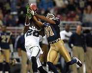 St. Louis Rams wide receiver Torry Holt (81) pulls in a touchdown pass late in the fourth quarter over Seattle safety Michael Boulware (28), giving the Rams a 28-27 lead at the Edward Jones Dome in St. Louis, Missouri, October 15, 2006.  The Seahawks beat the Rams 30-27.<br />
