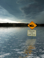 Flooded road sign.<br /> <br /> Larger JPEG + TIFF images available by contacting use through our contact page at :..www.photography4business.com