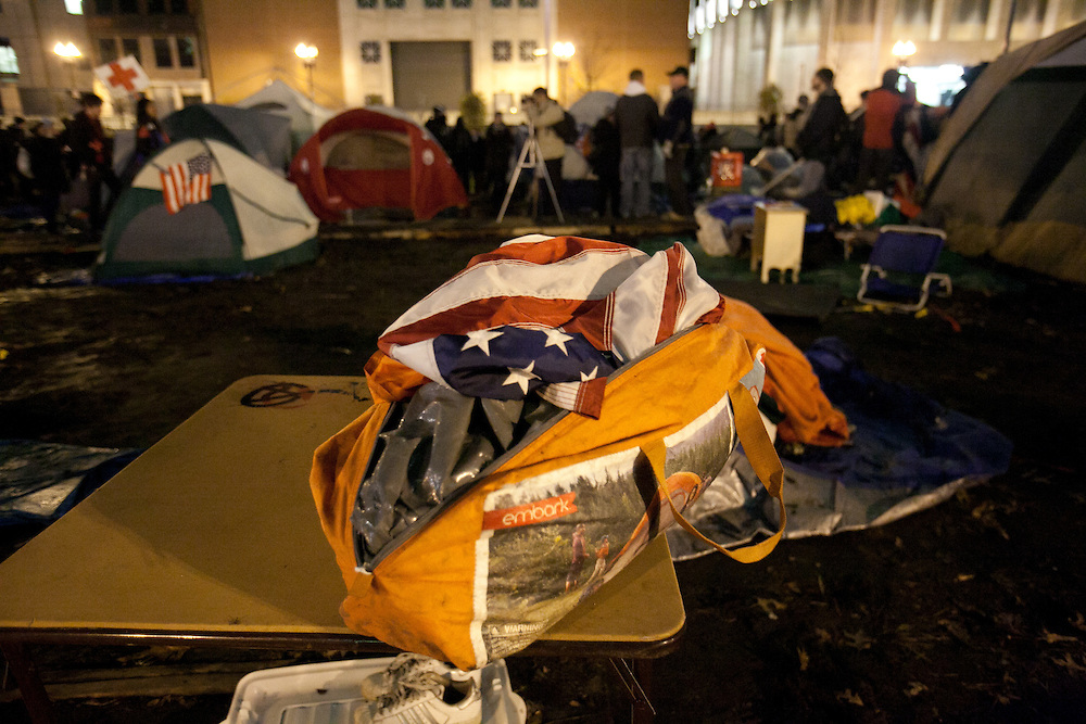 Boston, MA 12/08/2011.An American flag sits on top of a packed up tent in the Occupy Boston campsite at Dewey Square..Alex Jones / www.alexjonesphoto.com