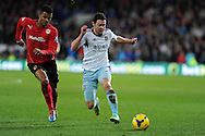 West Ham's Matt Jarvis ® goes past Cardiff's  Fraizer Campbell. Barclays Premier league, Cardiff city v West Ham Utd match at the Cardiff city Stadium in Cardiff, South Wales on Saturday 11th Jan 2014.<br /> pic by Andrew Orchard, Andrew Orchard sports photography.