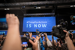 """11 December 2019, Madrid, Spain: """"#TimeForAction is Now"""" reads an official signboard at COP25 as media gather to cover hundreds of civil society and other actors holding an unauthorized protest outside the plenary hall of COP25 in Madrid, to draw attention to the failures of the climate talks and to call on rich countries to step up and pay up for real solutions, and to highlight the threat of loopholes, false solutions like carbon markets, and the need for those who caused the climate crisis to pay up for loss and damage while respecting human rights."""