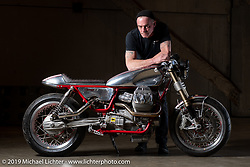 Rodsmith Motorcycles' Craig Rodsmith and his cafe racer inspired 2017 turbocharged Moto Guzzi v9 Sport with hand formed aluminum skins at the Handbuilt Show. Austin, TX. USA. Friday April 20, 2018. Photography ©2018 Michael Lichter.