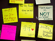 """06 JULY 2015 - BANGKOK, THAILAND:  A wall covered in """"Post It"""" notes related to the arrest of 14 students for violating orders related to political assembly. More than 100 people gathered at Thammasat University in Bangkok Monday to show support for 14 students arrested two weeks ago. The students were arrested for violating orders against political assembly. They face criminal trial in military courts. The students' supporters are putting up """"Post It"""" notes around Bangkok and college campuses up country calling for the students' release.     PHOTO BY JACK KURTZ"""