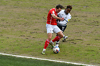 Football - 2020 / 2021 Sky Bet Championship - Swansea City vs Barnsley - Liberty Stadium<br /> <br /> Callum Brittain of Barnsley  challenged by Jamal Lowe of Swansea<br /> <br /> COLORSPORT/WINSTON BYNORTH