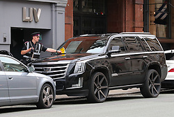 A parking attendant is seen applying a £60 parking ticket to Marcos Roja's car as he attends Ander Herrera's Birthday Lunch at Tapeo & Wine Restaurant in Manchester