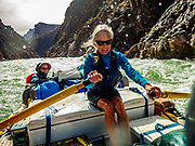 AZRA Trip leader Lorna Corson rows a rapid on Day 6 of 16 days rafting 226 miles down the Colorado River in Grand Canyon National Park, Arizona, USA. For this photo's licensing options, please inquire at PhotoSeek.com.