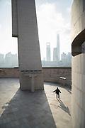 Man playing tennis near the Shanghai Monument To Peoples Heroes, Huangpu Park, The Bund, Shanghai, China