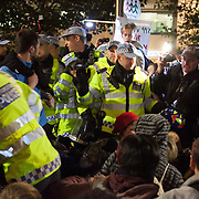 Police moving in to re-capture the steps to the cathedral.  The London Stock Exchange was attempted occypied in solidarity with Occupy Wall in Street in New York and in protest againts the economic climate, blamed by many on the banks. Police managed to keep people away fro the Patornoster Sqaure and the Stcok Exchange and thousands of protestors stayid in St. Paul's Square, outside St Paul's Cathedral. Many camped getting ready to spend the night in the square.