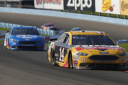 August 5, 2018 - Watkins Glen, New York, United States of America - Clint Bowyer (14) brings his car through the turns during the Go Bowling at The Glen at Watkins Glen International in Watkins Glen , New York. (Credit Image: © Chris Owens Asp Inc/ASP via ZUMA Wire)