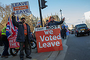 Pro-Brexit activists protest outside the Houses of Parliament on the 11th December 2018 in central London in the United Kingdom. Pro-Brexit and Anti Brexit campaigners congregate on the day of the proposed Brexit vote.