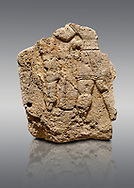 Picture & image of Hittite relief sculpted orthostat stone panel of Long Wall Limestone, Karkamıs, (Kargamıs), Carchemish (Karkemish), 900 - 700 B.C. Anatolian Civilizations Museum, Ankara, Turkey. The short-skirted figure with a dagger at the waist holds the gazelle from its hind legs<br /> <br /> On a gray background. .<br />  <br /> If you prefer to buy from our ALAMY STOCK LIBRARY page at https://www.alamy.com/portfolio/paul-williams-funkystock/hittite-art-antiquities.html  - Type  Karkamıs in LOWER SEARCH WITHIN GALLERY box. Refine search by adding background colour, place, museum etc.<br /> <br /> Visit our HITTITE PHOTO COLLECTIONS for more photos to download or buy as wall art prints https://funkystock.photoshelter.com/gallery-collection/The-Hittites-Art-Artefacts-Antiquities-Historic-Sites-Pictures-Images-of/C0000NUBSMhSc3Oo