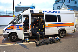© Licensed to London News Pictures . FILE PICTURE DATED 07/08/2011 . Tottenham , UK . After a night of rioting in Tottenham , police sleep in and around a riot van , parked in the middle of Tottenham High Road. Photo credit : Joel Goodman/LNP