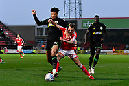 Omar Sowunmi (17) of Yeovil Town battles for possession with  Scott Twine (27) of Swindon Town during the EFL Sky Bet League 2 match between Swindon Town and Yeovil Town at the County Ground, Swindon, England on 10 April 2018. Picture by Graham Hunt.