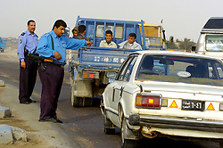 Members of the Iraqi Police Service man a Vehicle Check Point close to the Shia Flats. Policing in Iraq is now Iraqi lead with British Forces providing support mentoring and teaching along with offering skills the IPS have yet to learn and working on combined operations when requsted.