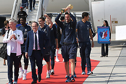 France's head coach Didier Deschamps, French Football federation president Noel Le Graet, Antoine Griezmann and goalkeeper Hugo Lloris, rising the trophy, disembark from the plane with teammates upon their arrival at the Roissy-Charles de Gaulle airport on the outskirts of Paris, France, on July 16, 2018 after winning the Russia 2018 World Cup final football match. Photo by ABACAPRESS.COM