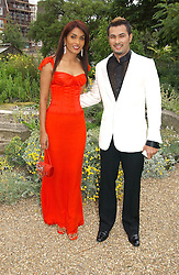 BERNARD & MARY CHADRAN at a fund raising event for The Galapagos Conservation Trust entitled 'Some Enchanted Evening' at the Chelsea Physic Garden Chelsea, London on 17th June 2004.