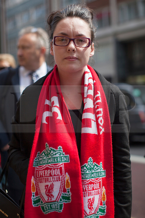 © licensed to London News Pictures. London, UK 25/04/2013. Lian Hawley, who lost her father David Hawley, joins other families of the 96 football fans who lost their lives in the Hillsborough disaster at the Family Division of the High Court in London on Thursday, 25 April 2013. A hearing to decide the date and location of a new inquest into the 96 people who died in the Hillsborough disaster has begun in London. Photo credit: Tolga Akmen/LNP