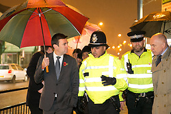 © Licensed to London News Pictures. 03/11/2015. Alum Rock, Birmingham, UK. Shadow Home Secretary ANDY BURNHAM visiting Alum Rock in Birmingham to launch the Labour Policy on Policing. Pictured from left to right, ANDY BURNHAM, Sgt IFTI ALI, Inspector CHRIS SMITH, MP JACK DROMEY. Photo credit : Dave Warren/LNP