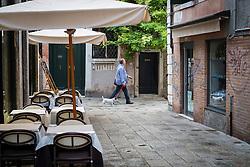 Walking the dog, early morning in Dorsoduro, Venice, Italy.<br /> Photo: Ed Maynard<br /> 07976 239803<br /> www.edmaynard.com