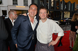 Left to right, GABRIELE ESPOSITO General Manager of Daphne's and MIKE BROWN head chef at Daphne's at the 50th anniversary party for Daphne's restaurant, 112 Draycott Avenue, London held on 24th June 2014.