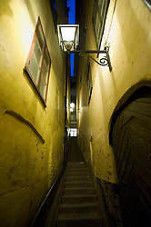 Narrow alleyway at night in Gamla Stan old town district of Stockholm Sweden