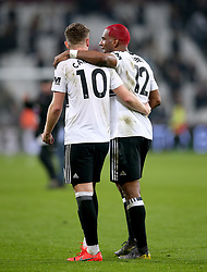 Fulham's Tom Cairney (left) and Ryan Babel hug each other at the end of the Premier League match at London Stadium.