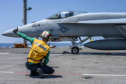 May 23, 2019 - Philippine Sea - Navy Petty Officer 3rd Class Killian Rush signals the launch of an F/A-18E Super Hornet during flight deck operations on the aircraft carrier USS Ronald Reagan in the Philippine Sea, May 23, 2019. (Credit Image: © U.S. Navy/ZUMA Wire/ZUMAPRESS.com)