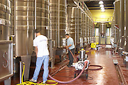 Pumping over. Fermentation tanks. Chateau Reignac, Bordeaux, France