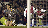 Photo. Jed Wee.<br /> Everton v Arsenal, FA Barclaycard Premiership, Goodison Park, Liverpool. 07/01/2004.<br /> Arsenal's Ashley Cole (R) congratulates goalscorer Nwankwo Kanu as Everton goalkeeper Nigel Martyn looks despondent.