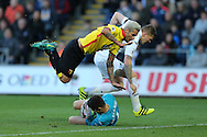 Valon Behrami of Watford falls over Swansea city goalkeeper Lukasz Fabianski as the Swansea keeper makes a save. Premier league match, Swansea city v Watford at the Liberty Stadium in Swansea, South Wales on Saturday 22nd October 2016.<br /> pic by  Andrew Orchard, Andrew Orchard sports photography.